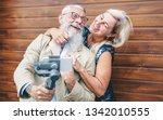 happy seniors couple recording... | Shutterstock . vector #1342010555
