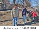 family walking along promenade. ...   Shutterstock . vector #1342025048