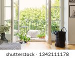 real photo of open door to... | Shutterstock . vector #1342111178