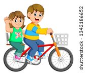 happy couple riding a bicycle | Shutterstock . vector #1342186652