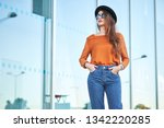 stylish pretty young woman... | Shutterstock . vector #1342220285