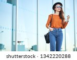 stylish pretty young woman... | Shutterstock . vector #1342220288