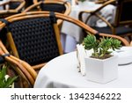 cafe table with wicker chairs.... | Shutterstock . vector #1342346222