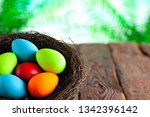 colored easter eggs in the nest ...   Shutterstock . vector #1342396142