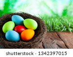 colored easter eggs in the nest ...   Shutterstock . vector #1342397015