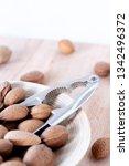 almonds on wood bag nutcracker   Shutterstock . vector #1342496372