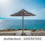 parasol with two deck chairs on ... | Shutterstock . vector #1342507652