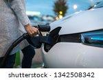 young woman charging an... | Shutterstock . vector #1342508342