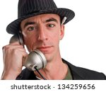 Headshot of a Caucasian Male Wearing a Fedora Style Hat and Talking on the Phone - Closeup - stock photo