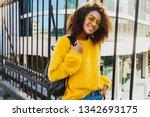 playful black woman looking in...   Shutterstock . vector #1342693175