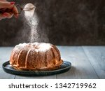 woman's hand sprinkling icing... | Shutterstock . vector #1342719962
