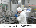 two workers at production line... | Shutterstock . vector #134273726