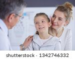 little girl with her mother at...   Shutterstock . vector #1342746332