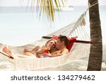 Romantic Couple Relaxing In...
