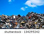 Metal waste on a recycling plant with sky and clouds - stock photo