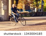 cyclist in motion blur rides on ... | Shutterstock . vector #1343004185