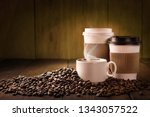 coffee cup and coffee beans on... | Shutterstock . vector #1343057522