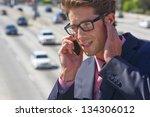 businessman speaking on mobile... | Shutterstock . vector #134306012