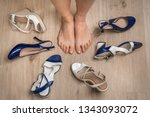 young woman choosing shoes and...   Shutterstock . vector #1343093072