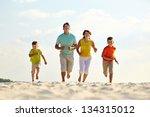 photo of happy family running... | Shutterstock . vector #134315012