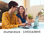happy woman making payment... | Shutterstock . vector #1343163845