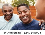 three generations of family men ... | Shutterstock . vector #1343195975