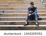 businessman sit on stair use... | Shutterstock . vector #1343209352