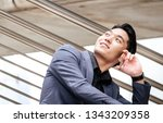 businessman sit on stair use... | Shutterstock . vector #1343209358