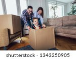 happy family moving home with... | Shutterstock . vector #1343250905