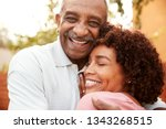 senior black man and his middle ...   Shutterstock . vector #1343268515