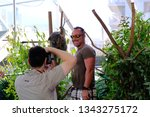 visitor is taking photo with... | Shutterstock . vector #1343275172
