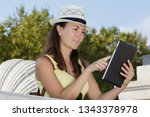hipster woman using tablet outdoros