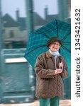 happy mature woman in jacket... | Shutterstock . vector #1343421632
