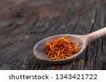 saffron in a spoon on a dark... | Shutterstock . vector #1343421722