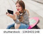 young hipster woman in street... | Shutterstock . vector #1343431148