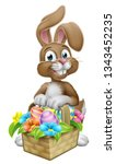 Stock photo an easter bunny rabbit cartoon character with a basket on an easter egg hunt 1343452235