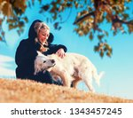 young woman and her pets having ... | Shutterstock . vector #1343457245