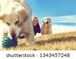 young woman and her pets having ... | Shutterstock . vector #1343457248