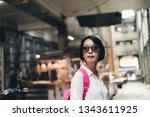traveling asian woman walk in... | Shutterstock . vector #1343611925