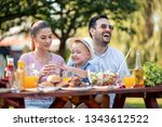 family having a barbecue in the ... | Shutterstock . vector #1343612522