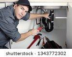 plumber repairs a sink.   Shutterstock . vector #1343772302
