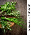 fresh herbs on wooden table | Shutterstock . vector #134384342