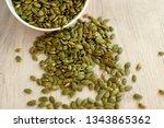 pumpkin seeds scattered on the... | Shutterstock . vector #1343865362