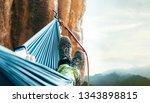 climber resting in hammock on... | Shutterstock . vector #1343898815