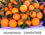 close up of oranges with green...