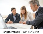 couple signing contract with... | Shutterstock . vector #1344147245