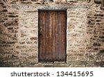 ancient wooden door in stone...