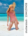 woman in one piece swimsuit at... | Shutterstock . vector #1344159458