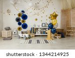 Stock photo birthday navy blue and gold decorations with gifts toys garlands and figure for little baby party 1344214925