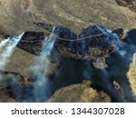 the smoke from the burning of... | Shutterstock . vector #1344307028